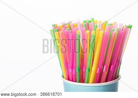 Bunch Of Multi Colored Plastic Straws In Disposable Biodegradable Paper Cup Isolated On White Backgr