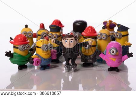 Los Angeles, Usa - August 17, 2020: Minions And Young Felonius Gru Toys Isolated On White Background