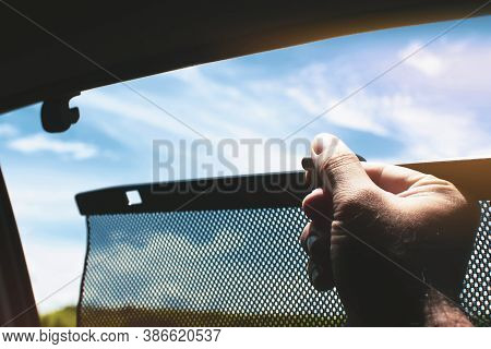 Driver Is Lifting Car Side Window Curtains Sunshades For Sunlight Protect