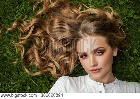 Beautiful Summer Woman On Green Grass Outdoors