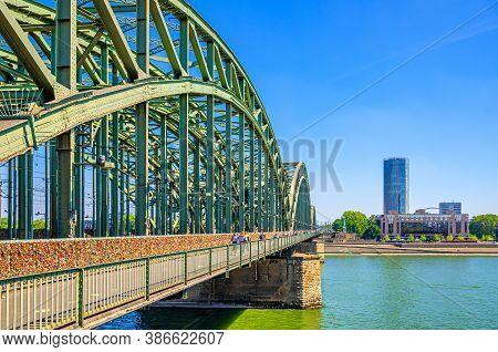 The Hohenzollern Bridge Or Hohenzollernbrucke Across Rhine River, Pedestrian And Railway Steel Bridg