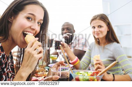 Top View Of Group Of People Having Dinner Together While Sitting At Wooden Table. Food On The Table.