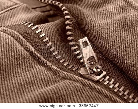 sepia toned denim fragment with zipper