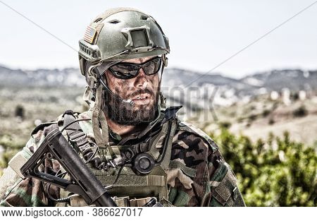 Shoulder Portrait Of Army Soldier, Special Forces Fighter, Modern Warfare Combatant With Dirty, Unsh
