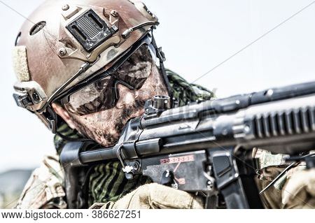 Close Up Portrait Of Army Special Forces Soldier, Commando Rifleman, Seals Fighter With Dirty Face,