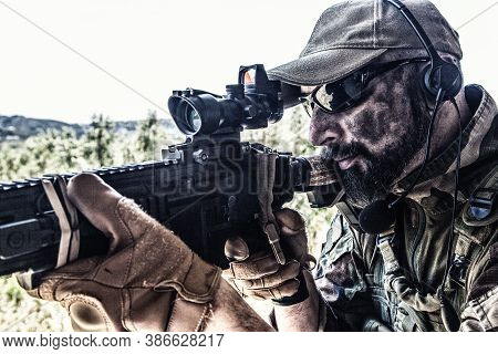 Army Special Forces Soldier, Modern Combatant With Dirty, Unshaven Face, In Combat Uniform, Glasses