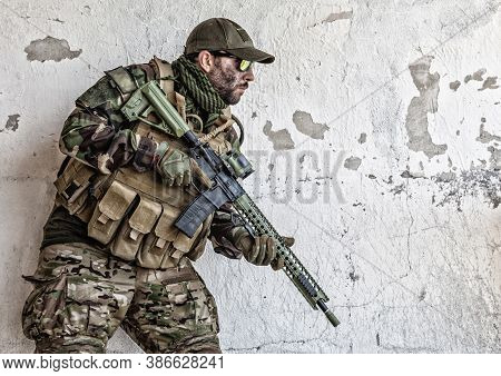 Army Soldier, Special Operations Forces Rifleman In Camouflage Uniform, Load Carrier, Glasses And Ca