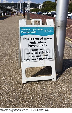 Weston-super-mare, Uk - August 2, 2019: A Sign Warning That Pedestrians Have Priority Over Cyclists