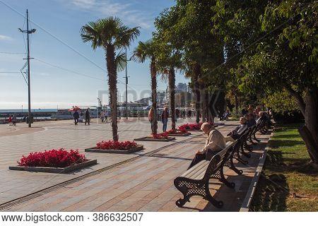 Yalta, Crimea, Russia - November 04, 2018: Yalta Embankment On A Sunny Autumn Day. People Relax On T