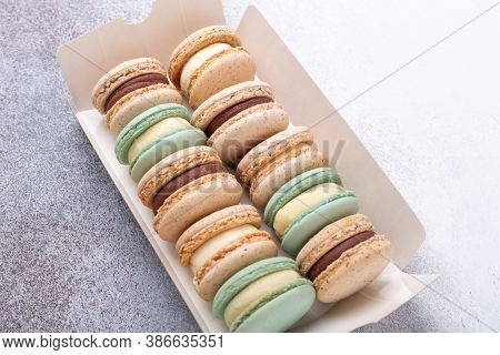 Macaroons In Box On Stone Background. Delicious French Macarons. Copy Space, Top View - Image