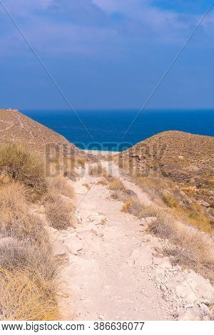 Trail Down To La Playa De Los Muertos In The Natural Park Of Cabo De Gata, Nijar, Andalucia. Spain