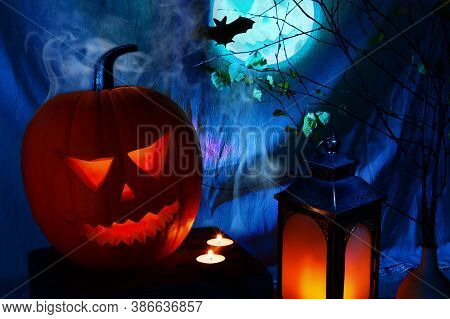 Spooky Jack-o'-lantern With Halloween Moon And Lantern On The Blue Background
