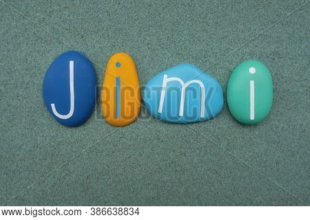 Jimi, Masculine Given Name Composed With Multicolored Stone Letters Over Green Sand