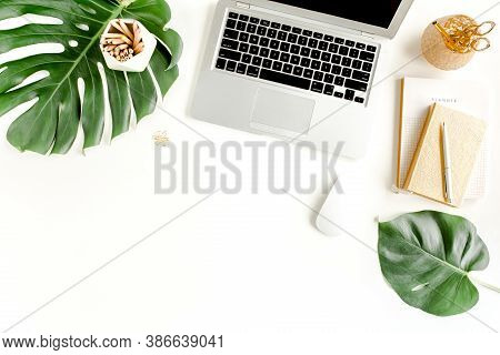 Flat Lay Home Office Desk. Female Workspace With Laptop, Tropical Palm Leaves Monstera, Accessories