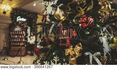Close Up Of Part Of Christmas Tree With Different Christmas Toys And Garland In Shopping Center. Con