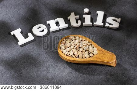 Lens Culinaris - Dried And Uncooked Lentils In The Wooden Spoon