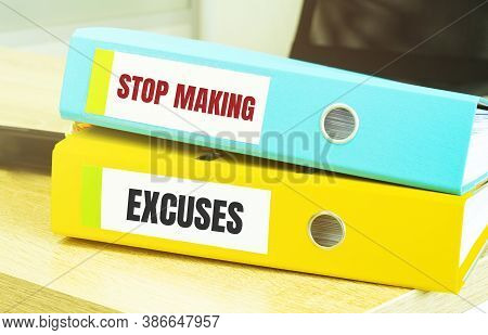 Two Office Folders With Text Stop Making Excuses