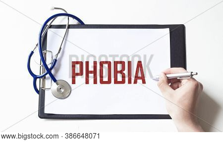 Doctor Holding A Paper Plate With Text Phobia, Medical Concept
