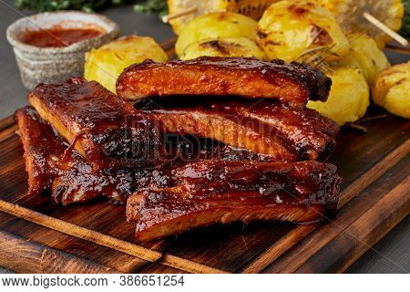 Barbecue Pork Ribs And Crushed Smashed Potatoes. Slow Cooking Recipe