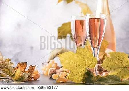 Rose Pink Champagne Glasses And Bottle, Gray Background, Wine Tasting Concept, Copy Space