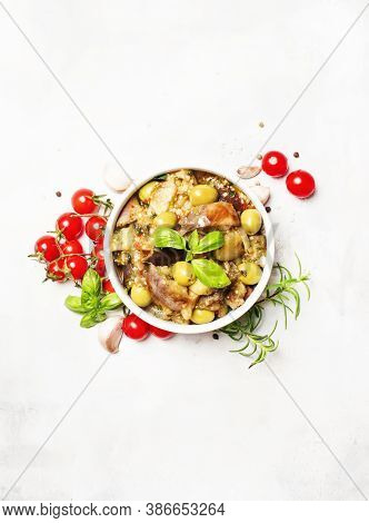 Stewed Aubergines With Vegetables And Herbs In A Bowl, Light Background, Top View