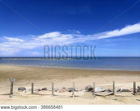 Beautiful Sky And Blue Sea.clouds On Blue Sky Over Calm Sea With Sunlight.