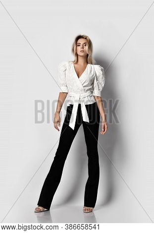 Daring Impudent Tall Blonde Slim Woman Model In Office Pantsuit Shirt With Deep Neckline And Pants S