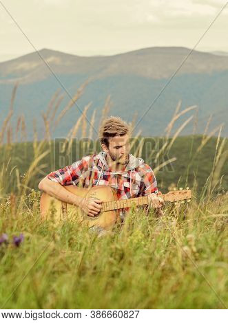 Playing Music. Silence Of Mountains And Sound Of Guitar Strings. Hipster Musician. Inspiring Environ