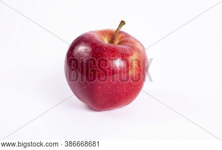 Fresh Organic Apple . Isolated On White Background Red Apple. Juicy Red Tasty Fruit.