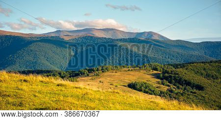 Beautiful Rural Landscape In Autumn. Field On Hillside In Mountains In Evening Light