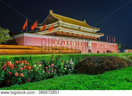Beijing, China - May 13, 2018: Mao Tse Tung Tiananmen Gate in Gugong Forbidden City Palace. Chinese Sayings on Gate Are