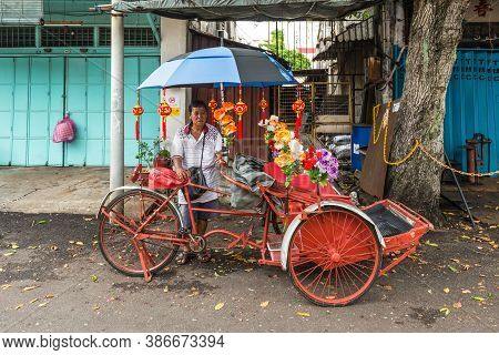 George Town, Penang, Malaysia - December 1, 2019: Street Life Of Trishaw Driver In George Town, Pena
