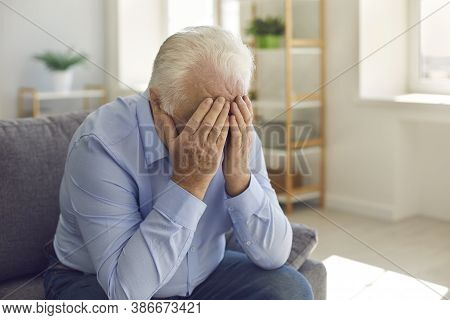 Elderly Man, Grieving About Death Of Relative Or Forgotten By Family, Crying Alone