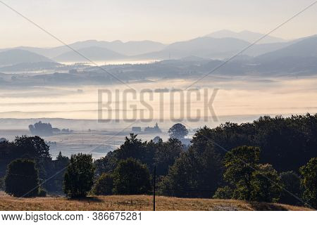 Sunrise In Valley Nature Landscape. Mountain Layers Landscape In Sunrise. Summer In Mountain Meadow