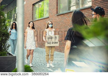 Covid-19, Keep Distance. Dude With Sign - Woman Stands Protesting Things That Annoy Her. Solo Demons