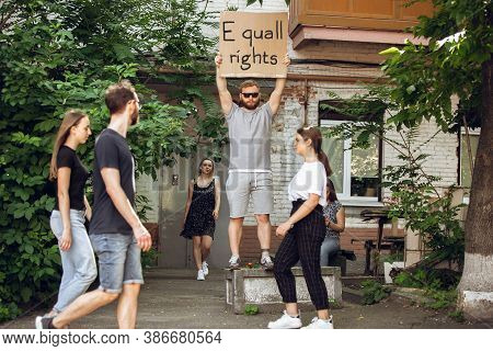 Equall Rights. Dude With Sign - Man Stands Protesting Things That Annoy Him. Solo Demonstration His