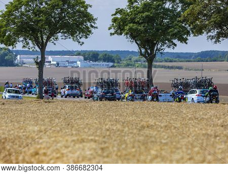 Vendeuvre-sur-barse, France - 6 July, 2017: Row Of Technical Vehicles At The End Of The Peloton Pass
