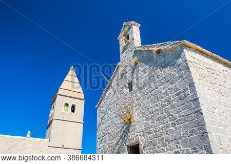 Ancient Coastal Town Of Lubenice On The Island Of Cres In Croatia, Old Stone Church And Tower Bell