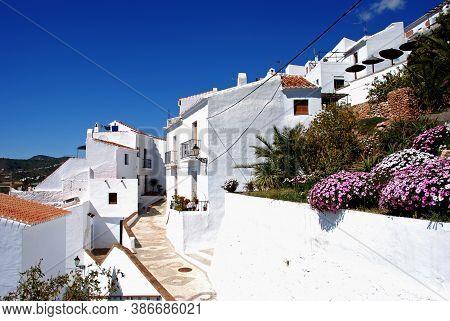 Typical Street In Whitewashed Village, Frigiliana, Malaga Province, Andalucia, Spain, Europe.