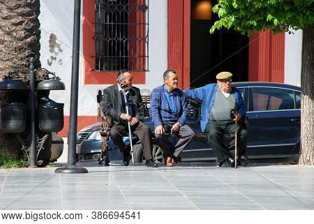 Carmona, Spain - April 07, 2009 - Elderly Men Sitting In The Plaza De San Fernando, Carmona, Spain -