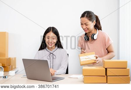 Asian Woman Business Two People Owner With Many Parcel Boxes On The Table Happy Online Sales Job, Us
