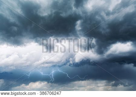 Dramatic storm clouds with rain and lightning closeup. Nature background