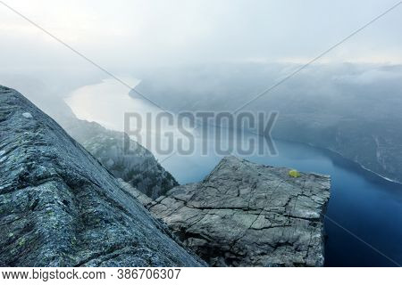 Alone tent near Trolltunga rock - most spectacular and famous scenic cliff in Norway