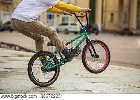 Bmx Rider On Black Bmx In Doing Acrobtic Stunts In The Street. Urban Male Sports Outdoor Activity Co