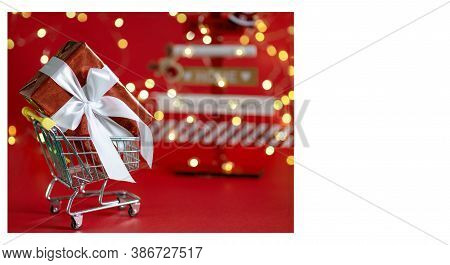 Winter Holidays, Christmas, Advertising Concept - Mini Shopping Car With Red Gift Box Inside, White