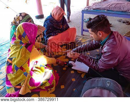 District Katni, India - January 16, 2020: Woman Finger Touching Electronic Thumb Pad Machine During