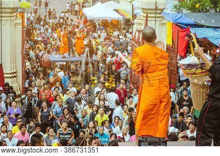 Nakhon Pathom Thailand - November 16 :  Unidentified Thai Monks Bestowed Ribbon-flowers On The Poor/