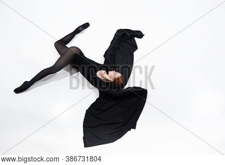 Like A Bat. Young And Graceful Ballet Dancer In Minimal Black Style Isolated On White Studio Backgro