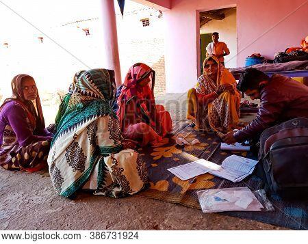 District Katni, India - January 16, 2020: Indian Village Women Crowd For Micro Finance Loan Repaymen