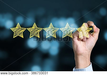 Businessman Writing Yellow Five Star To Customer Evaluation Service And Product. Marketing Review An